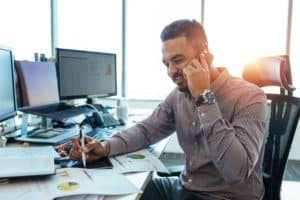 Man in the office using the best phone etiquette