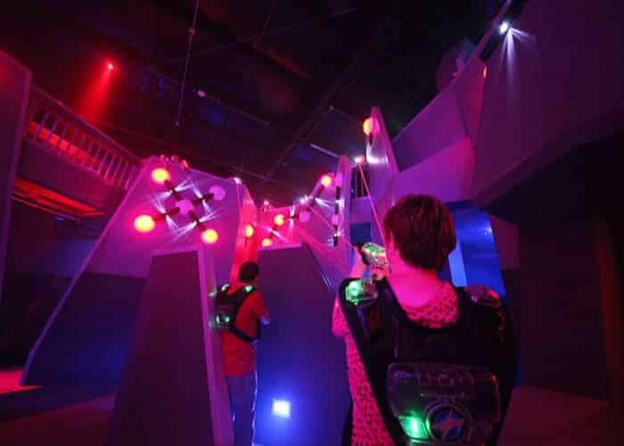 Two boys going up ramp in laser tag room