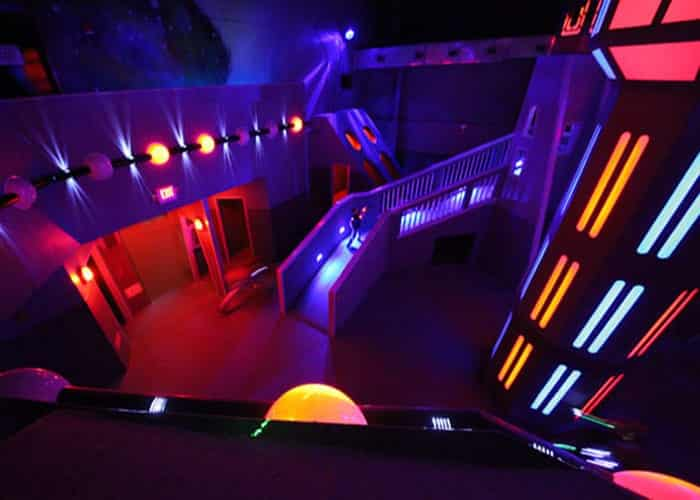 Dark room with colorful lights for laser tag game