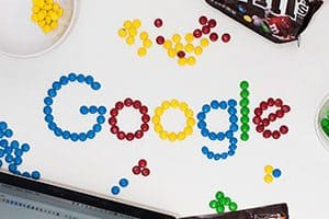Mobile ad with Google spelled out with M&Ms.