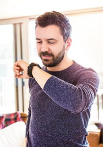 Man using smart watch to do a voice search